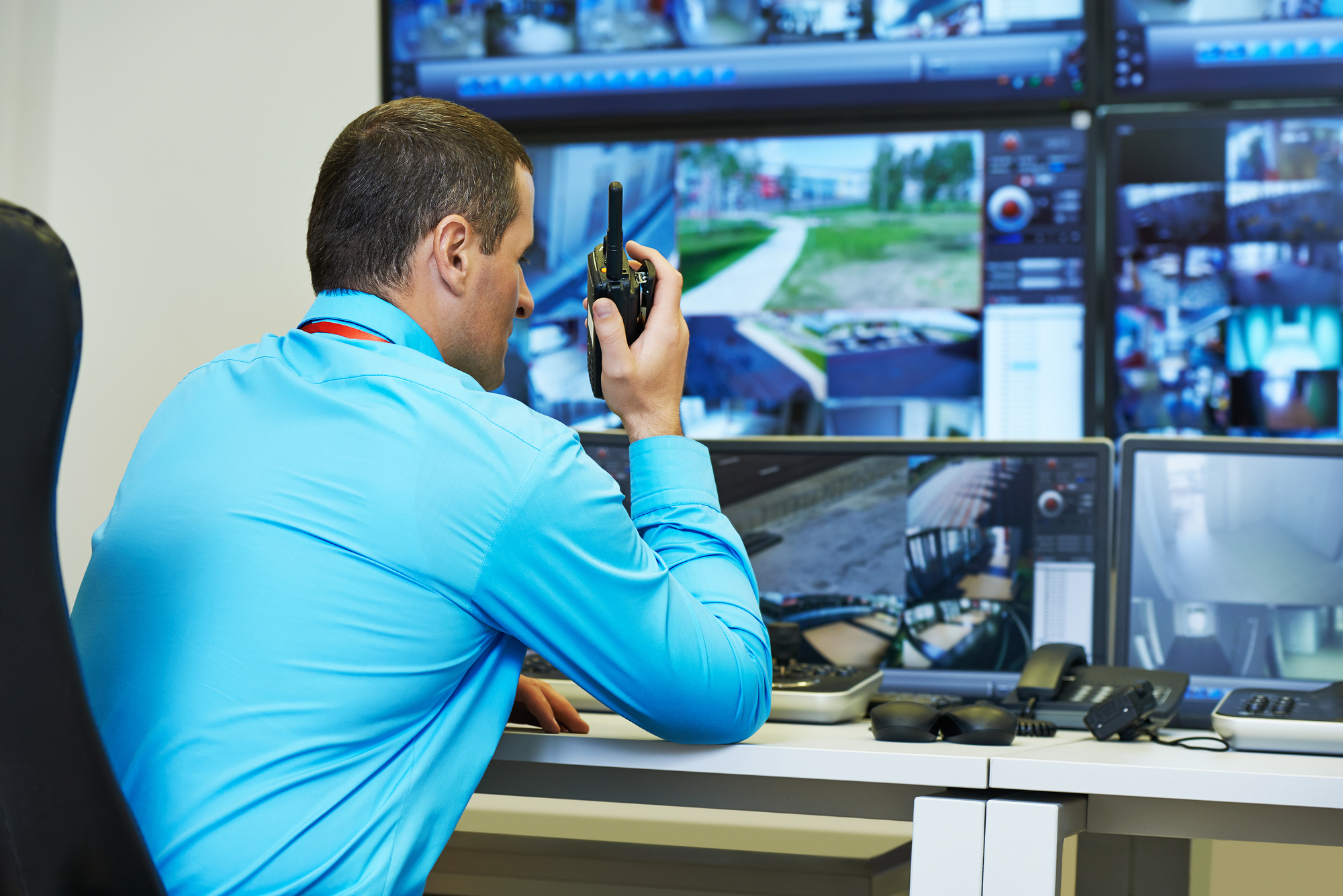 security guard watching video monitoring surveillance security s